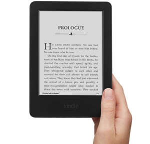 Image of a kindle being held in someone's right hand