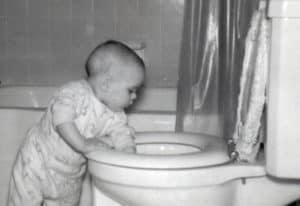 Photo of Robb Lightfoot as an infant fishing around in a toilet bowl. This may be bad, but realize that someone stood there with a camera, taking this picture, before -- I hope -- he was stopped. But who knows. He may still be there.